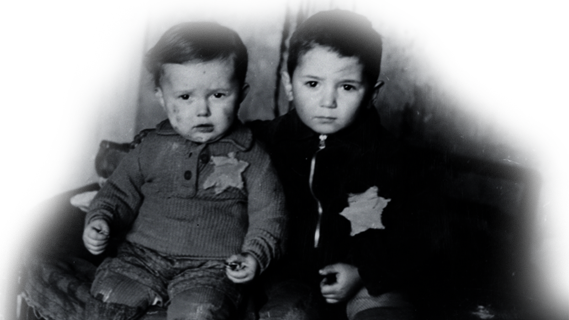Two young boys wearing jewish stars